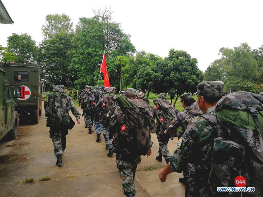 A Chinese People\'s Liberation Army (PLA) medical team leaves the Lao capital of Vientiane for Attapeu, Laos, July 25, 2018. A medical contingent from the Chinese People\'s Liberation Army (PLA), which is on the \