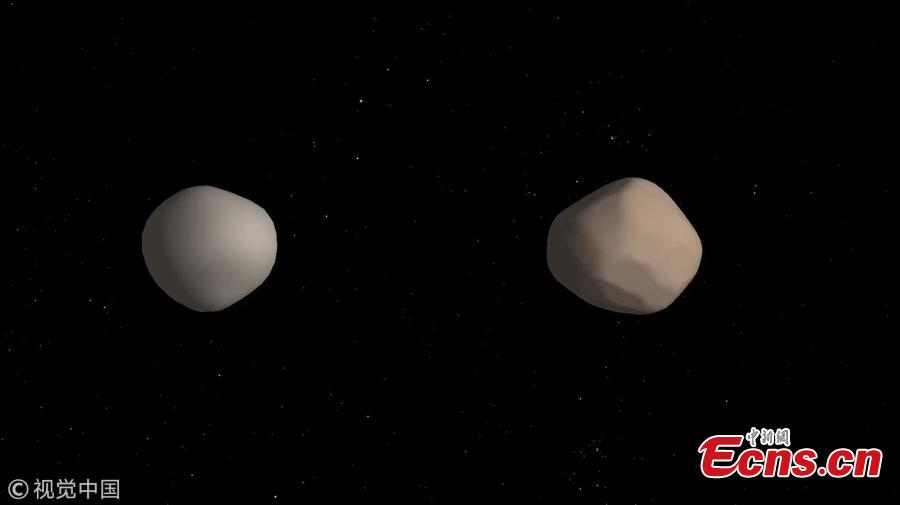 Artist\'s concept of what binary asteroid 2017 YE5 might look like.(Photo/VCG)