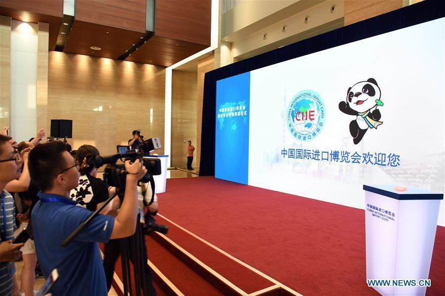Journalists work at an unveiling ceremony of the mascot and logo of the China International Import Expo (CIIE) in Shanghai, east China, July 27, 2018. China unveiled the mascot and the logo for the expo on Friday. (Xinhua/Jin Liangkuai)