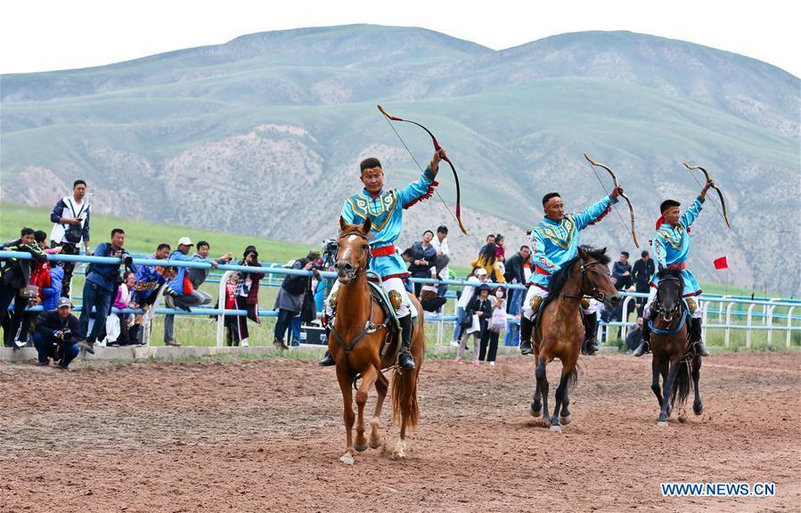 Horsemen perform equestrianism during a traditional ethnic minorities sports meeting held at a racecourse in Sunan Yugur Autonomous County, northwest China\'s Gansu Province, July 28, 2018. (Xinhua/Wang Jiang)
