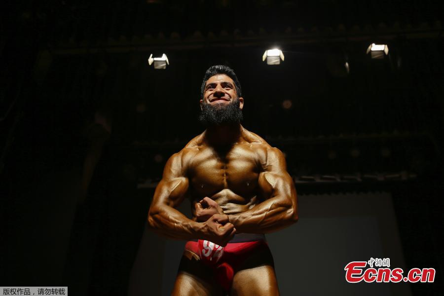 A Kashmiri bodybuilder displays his muscles at a bodybuilding competition in Srinagar, Indian controlled Kashmir, July 28, 2018. Dozens participated in the competition to choose Mr. Kashmir on Saturday. (Photo/Agencies)
