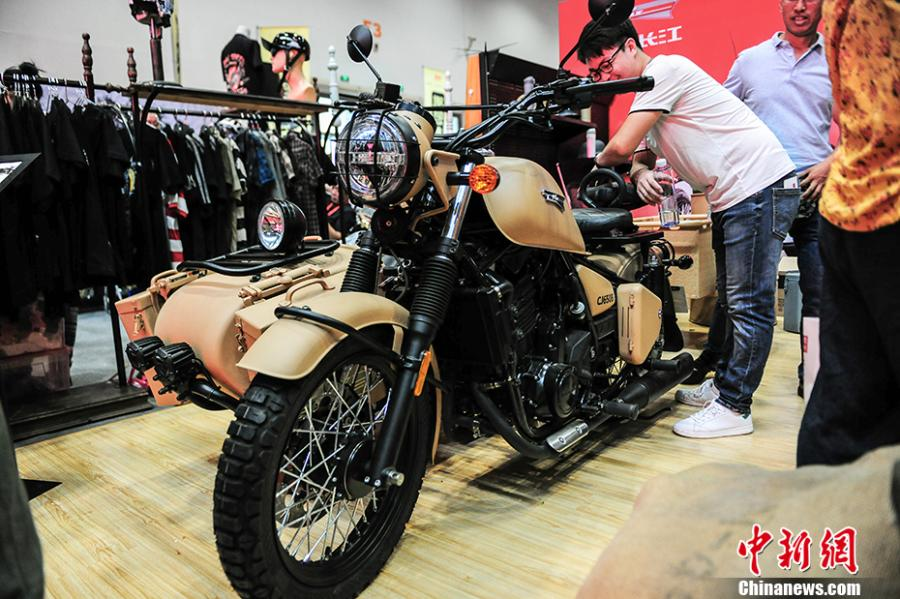 Photo taken on July 28- 29, 2018 shows a motorcycle exhibition held at the China National Convention Center in Beijing. Organized by an online auto platform, the fair displayed hundreds of motorcycles from home and abroad, such as the Ducati 959 sport bike, vintage Changjiang 650 sidecar, the Harley-Davidson WLA produced to the U.S. Army during the World War II and Benelli Leoncino bike. (Photo: China News Service/Fu Yu)