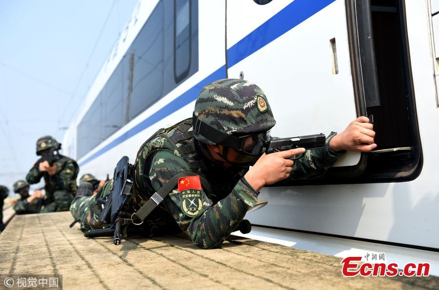 Armed police officers take part in a drill that simulated a hostage-taking crisis on a high-speed train in Hefei City, East China's Anhui Province, July 30, 2018. The drill aimed to enhance preparedness against transportation emergencies. (Photo/VCG)