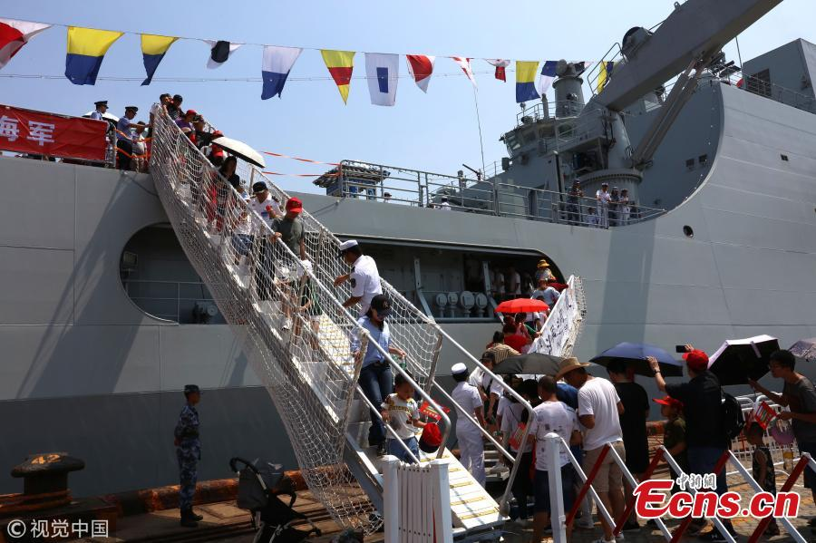 <?php echo strip_tags(addslashes(People visit the amphibious dock landing ship Jinggangshan of the PLA Navy in Quanzhou, Fujian Province, July 30, 2018, as the