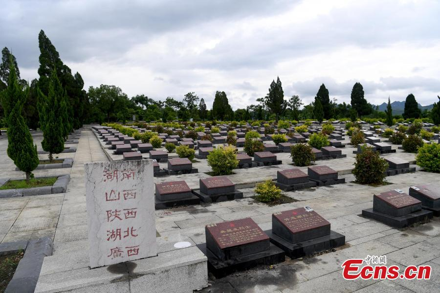 Niu Bentong, 62, works at a martyrs cemetery in Longzhou County, South China's Guangxi Zhuang Autonomous Region, July 30, 2018. Niu participated in the China-Vietnam war and witnessed the death of many of his comrades-in-arms in front of him. In 1980, Niu chose to work in the cemetery, where 1,902 martyrs lie, and he continued to work there for 37 years until his retirement this year. He has helped correct information related to more than 400 martyrs and has also shared details online. In his spare time, Niu continues to help at the cemetery, saying it's hard to forget the days of life and death spent alongside his fellow soldiers. (Photo: China News Service/Yu Jing)