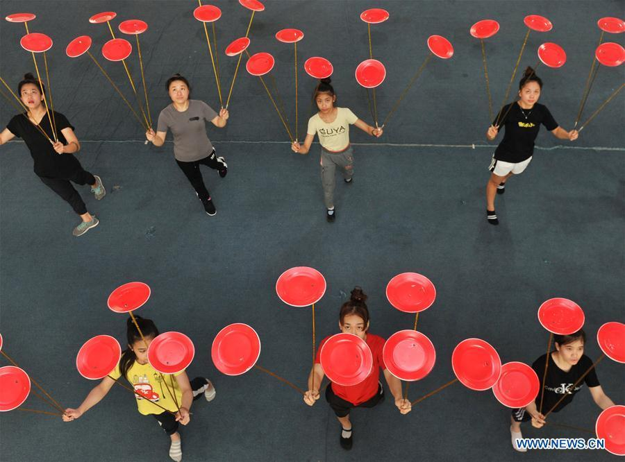 Students from Laos practise in Wuqiao Acrobatic Art School in Cangzhou, north China\'s Hebei Province, July 30, 2018. Wuqiao county is known as \