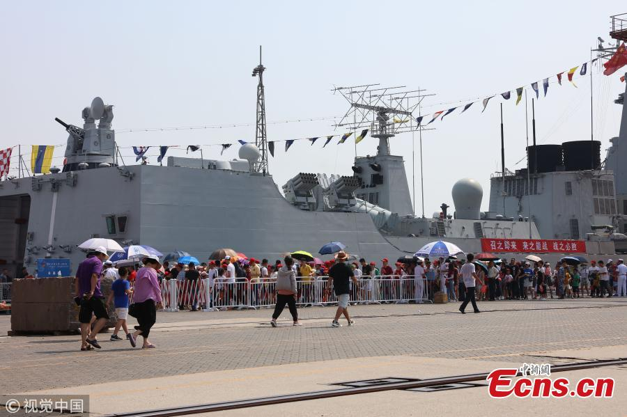 People visit the missile destroyer Changchun of the PLA Navy in Quanzhou, Fujian Province, July 30, 2018, as the \