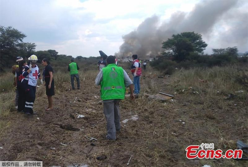 "Rescue workers and firefighters are seen at the site where an Aeromexico airliner has suffered an ""accident"" in a field near the airport of Durango, Mexico, Tuesday, July 31, 2018. (Photo/Agencies)"