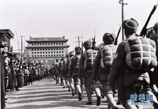 On January 31, 1949, the PLA peacefully entered and liberated Beiping (Beijing). (Photo/Xinhua)  The Pingjin Campaign was a decisive campaign fought between November 29, 1948, and January 31, 1949, by the PLA Northeast Field Army, two armies of the North China Field Army and part of local armed forces against Kuomintang troops over an area extending from Zhangjiakou in the west to Tanggu and Tangshan in the East, including Beiping and Tianjin. The PLA wiped out the defending Kuomintang forces in Xinbao\'an, Zhangjiakou and Tianjin.
