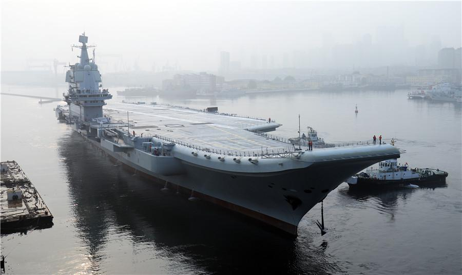 China\'s first domestically designed aircraft carrier set sail on its maiden sea trial on May 13, 2018. (Photo by Li Gang) The ship, the largest and most sophisticated naval vessel in China, was designed and built by the nation on its own. Currently, the Navy operates a sole aircraft carrier, CNS Liaoning, which was originally a Soviet-era vessel that was extensively refitted at the Dalian shipbuilder.