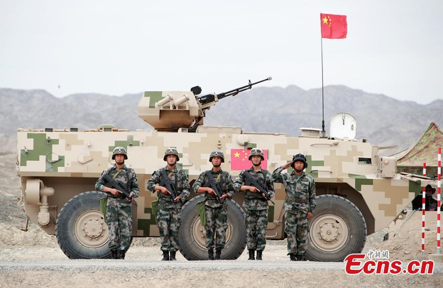 "Chinese soldiers pose for a photo during the ""Clear Sky"" contest at the International Army Games 2018 in Korla in Xinjiang Uygur Autonomous Region, July 31, 2018. China beat six other teams to win the contest. Three of the tournament events - \"