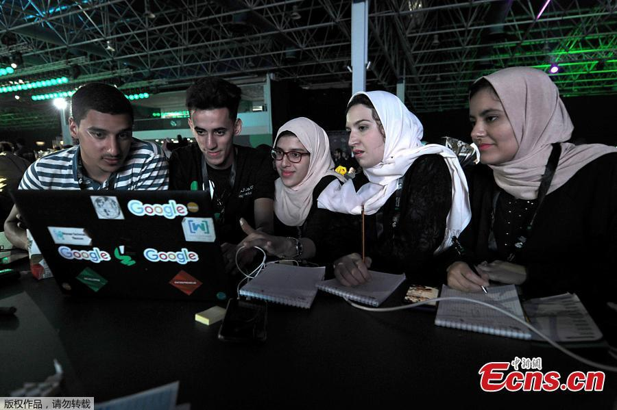People attend a hackathon in Jeddah on July 31, 2018, prior to the start of the annual Hajj pilgrimage in the holy city of Mecca. More than 3,000 software developers and 18,000 computer and information-technology enthusiasts from more than 100 countries take part in Hajj hackathon in Jeddah until August 3. The three-day event, believed to be one of the biggest of its kind in the Middle East, tasks participants with creating technology and applications that will help make the Hajj experience easier and more enjoyable for pilgrims. (Photo/Agencies)