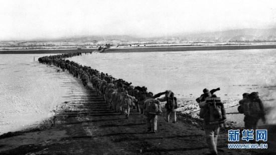 On the evening of October 19, 1950, the Chinese People\'s Volunteer Army valiantly crosses the Yalu River, marching toward the Korean battlefield. (File photo/Xinhua)  The Korean War began on June 25, 1950, and the Chinese People\'s Volunteer Army crossed the Yalu River on October 19, 1950, marking the beginning of the War to Resist U.S. Aggression and Aid Korea. In the following month, the PLA Northeast Frontier Force\'s four corps moved to the Yalu River\'s banks.  After entering the Democratic People\'s Republic of Korea, the Chinese People\'s Volunteer Army launched attacks and quickly drove the U.S.-led troops from the Chinese border back to the south of the 38th Parallel. The volunteer army then successfully stood their ground along the 38th Parallel and forced the US to propose ceasefire talks.