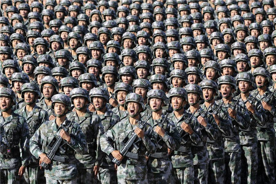 Troops train for a military parade at Zhurihe training base in North China\'s Inner Mongolia autonomous region, July 30, 2017. The parade was held to celebrate the 90th anniversary of the founding of the Chinese People\'s Liberation Army. (Photo by Feng Yongbin/China Daily)