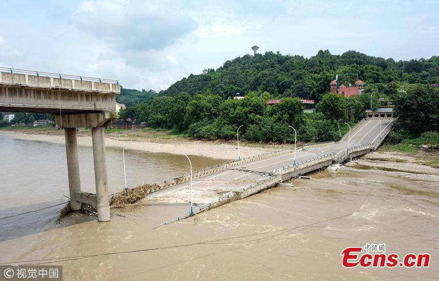 The Mingjiang River First Bridge collapses in Meishan City, Southwest China's Sichuan Province, July 27, 2018. The bridge collapsed 28 minutes after police stopped traffic from crossing it. The bridge opened to traffic in May 1994. No one was injured in the incident. (Photo/VCG)