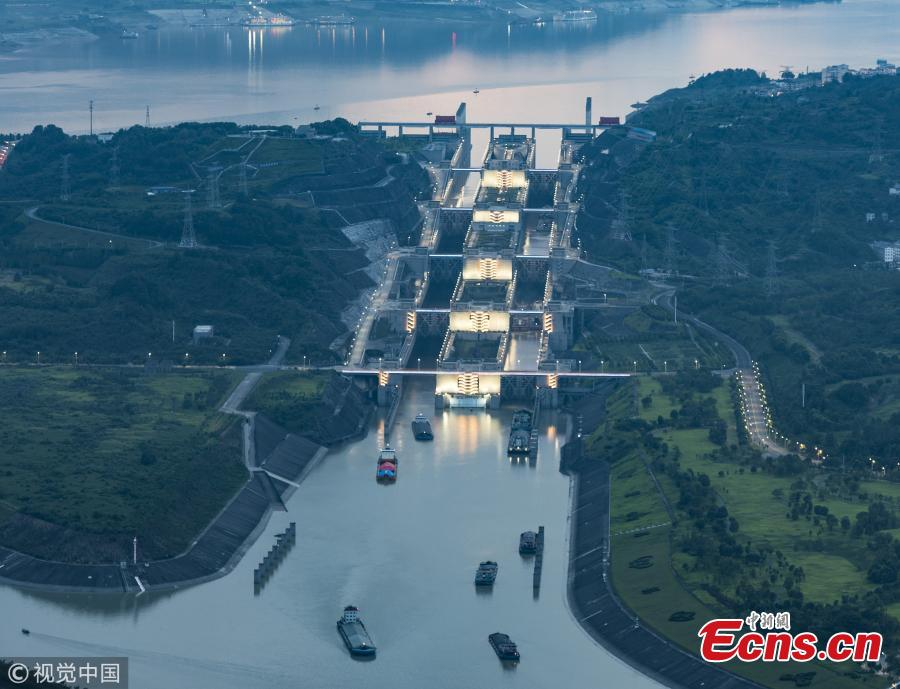Ships pass the Three Gorges Dam's five-stage ship lock in Yichang, Central China's Hubei Province, Aug. 1, 2018. Authorities made use of a break in continuous rain to ease shipping pressure between the Three Gorges Dam and the Gezhouba Dam, both large-scale water control projects on the Yangtze River. Previously, hundreds of ships were suspended to be both upstream and downstream of the Three Gorges Dam due to the massive amounts of floodwater - 35,000 cubic meters per second - being discharged from the dam, which affects navigation safety. (Photo/VCG)