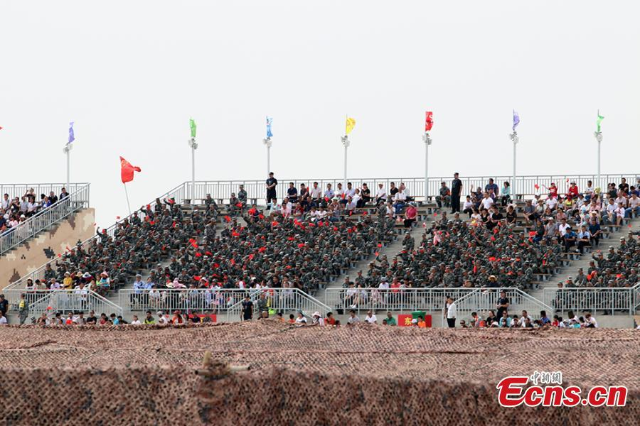 Public spectators and soldiers watch the \