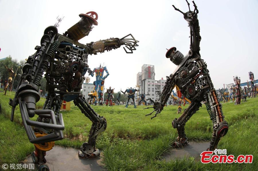 Transformer models made of steel are on display in a steel company in Xingtai City, North China's Hebei Province, Aug. 1, 2018. The company's park has 215 robot models of various styles and sizes, from 10.8 to 1.2 meters tall. Some weigh 25 kilograms and others, 11 tons. All the robot models were made by the company's employees out of used components. The London-based World Record Certification said the company has the world's largest collection of robot models. (Photo/VCG)