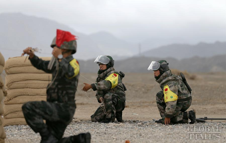 Chinese soldiers diligently work together to compete in the Safe Route Competition in Korla on August 2. Photo: Cui Meng/GT The Chinese team ranked first in the mine clearance race for the Safe Route Competition at the 2018 International Army Games in Korla, Northwest China's Xinjiang Uyghur Autonomous Region, on August 2.
