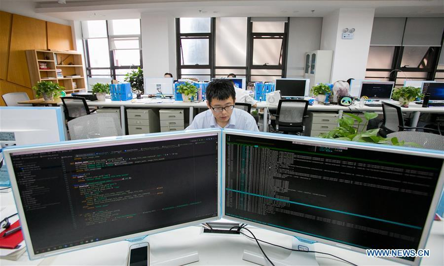 A staff member of BBD (Business Big Data) processes data in Guiyang, capital of southwest China\'s Guizhou Province, Aug. 2, 2018. BBD is a provider of big data solutions. Guizhou has become a pioneer in China\'s big data development. Big data is being widely applied in government management, business and daily life, contributing over 20 percent to the economic growth of Guizhou Province. The number of big data-related companies in Guizhou Province has grown from less than 1,000 in 2013 to more than 8,500 in 2018.(Xinhua/Li Jing)