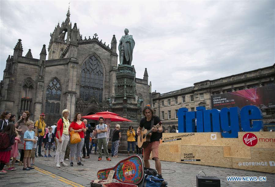 <?php echo strip_tags(addslashes(An Australian plays guitar on the opening day of the Edinburgh Festival Fringe 2018 in Edinburgh, Scotland, Britain on Aug. 3, 2018. (Xinhua/Han Yan))) ?>