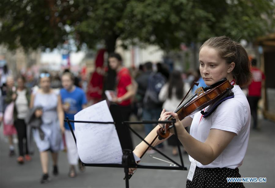 <?php echo strip_tags(addslashes(A woman plays violin on the opening day of the Edinburgh Festival Fringe 2018 in Edinburgh, Scotland, Britain on Aug. 3, 2018. (Xinhua/Han Yan))) ?>