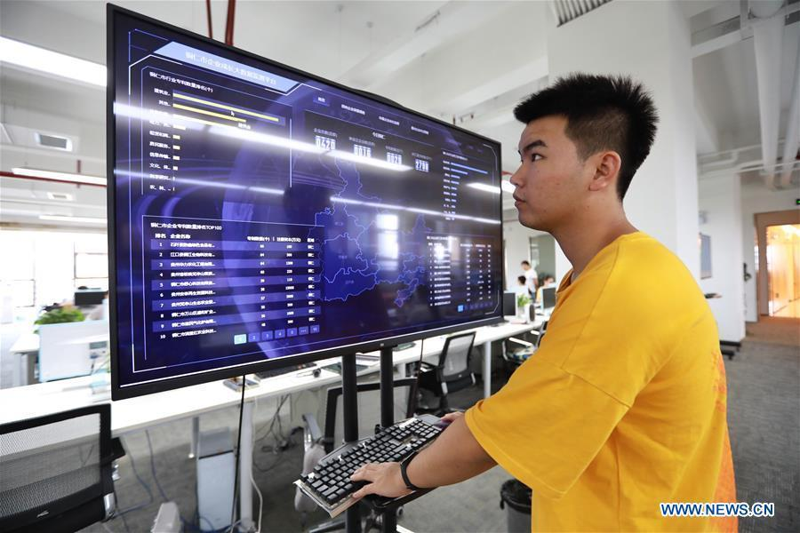 A staff member of BBD (Business Big Data) works in Guiyang, capital of southwest China\'s Guizhou Province, Aug. 2, 2018. BBD is a provider of big data solutions. Guizhou has become a pioneer in China\'s big data development. Big data is being widely applied in government management, business and daily life, contributing over 20 percent to the economic growth of Guizhou Province. The number of big data-related companies in Guizhou Province has grown from less than 1,000 in 2013 to more than 8,500 in 2018.(Xinhua/Liu Xu)