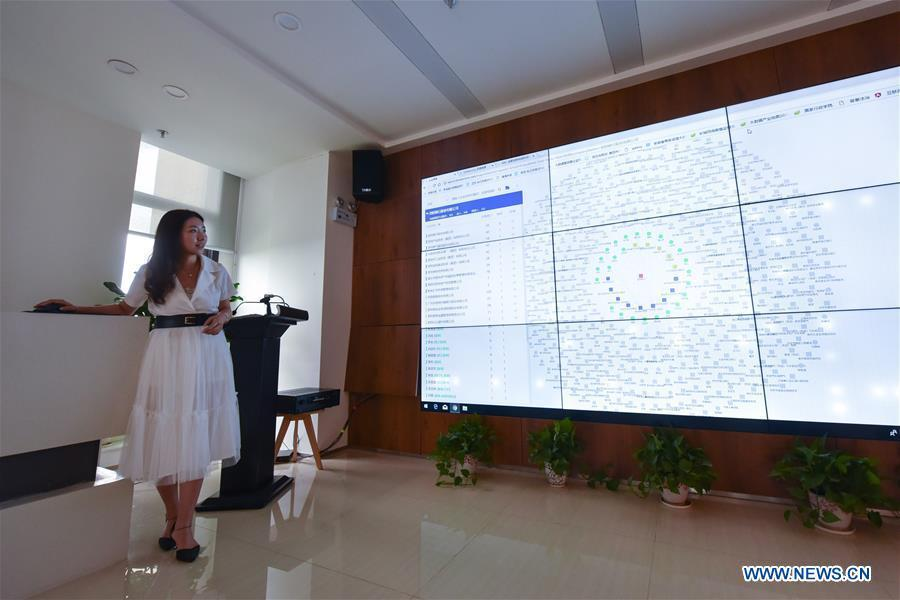 Dong Bo, the chief operating officer of BBD (Business Big Data), presents a big data product in Guiyang, capital of southwest China\'s Guizhou Province, Aug. 2, 2018. BBD is a provider of big data solutions. Guizhou has become a pioneer in China\'s big data development. Big data is being widely applied in government management, business and daily life, contributing over 20 percent to the economic growth of Guizhou Province. The number of big data-related companies in Guizhou Province has grown from less than 1,000 in 2013 to more than 8,500 in 2018.(Xinhua/Li Mangmang)
