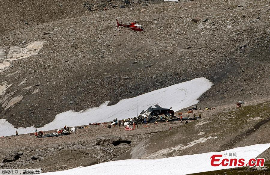 Accident investigators and rescue personnel work at the wreckage of a Junkers JU52 aircraft in Flims on August 5, 2018, after it crashed into Piz Segnas, a peak in eastern Switzerland on August 4. Twenty people are confirmed dead after a vintage World War II aircraft crashed into a Swiss mountainside, police reports said. The Junker JU52 HB-HOT aircraft, built in Germany in 1939 and now a collector's item, belongs to JU-Air, a company with links to the Swiss air force, the ATS news agency reported. (Photo/VCG)