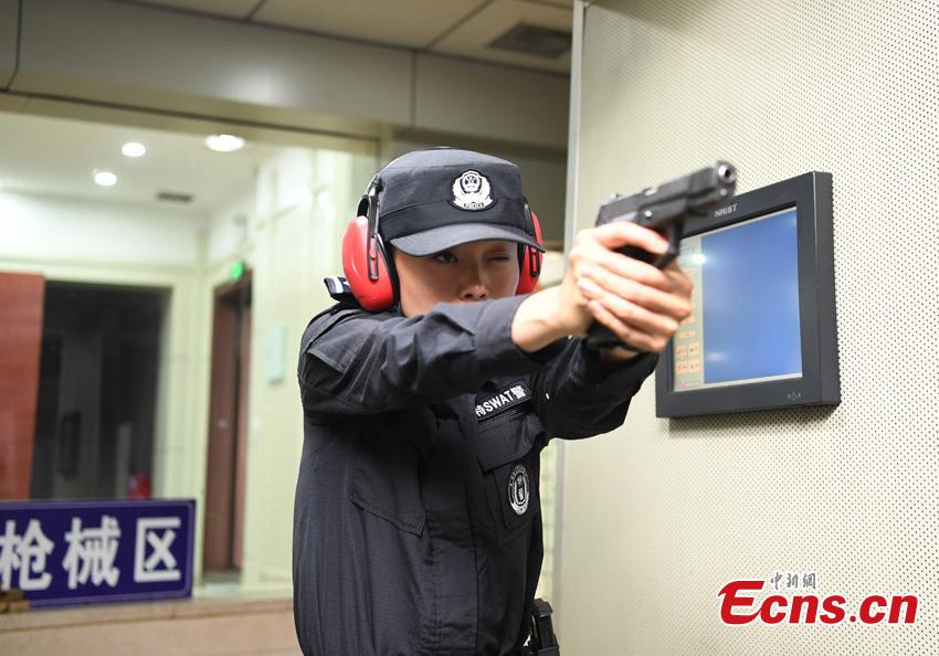Li Meixuan, a special police officer with the Changchun Railway Public Security Bureau, takes part in shooting training in Changchun City, Jilin Province. The 33-year-old puts high expectations on herself in training. Her team is predominantly responsible for emergency responses to terror attacks. She said she chooses to be a policewoman because of the influence of her father, also a police officer. (Photo: China News Service/Zhang Yao)