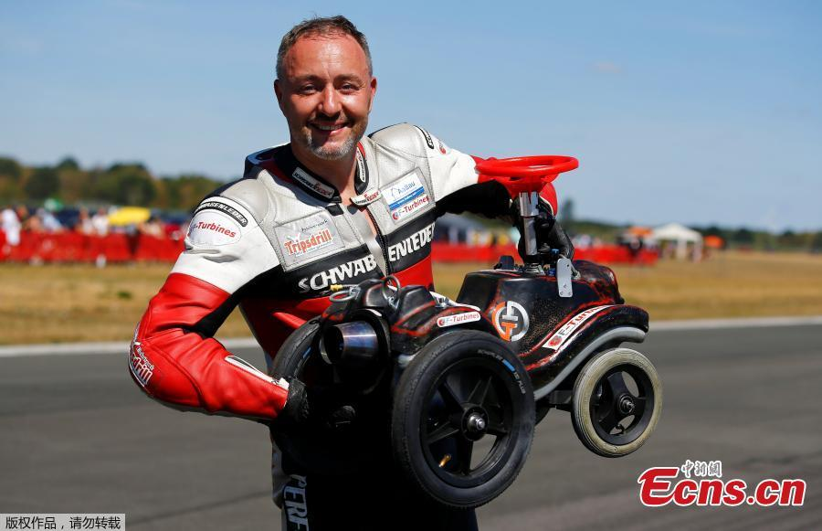 German extreme athlete Dirk Auer poses with his jet-powered Bobby car after setting a new world record at 119.68 km/h during an airport racing event in Bottrop-Kirchhellen, western Germany, Aug. 5, 2018. (Photo/Agencies)