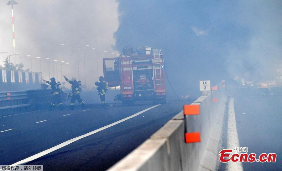 Firefighters work at the site of an explosion on a highway in the outskirts of Bologna, Italy, Aug. 6, 2018. The explosion killed at least two people and injured up to 70 as a section of the thoroughfare collapsed, police said. (Photo/Agencies)