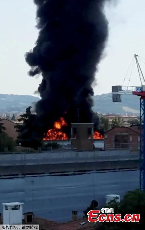 This frame grab taken from a video shows the moment a truck that was transporting flammable substances explodes after colliding with another truck on a highway in the outskirts of Bologna, Italy, Aug. 6, 2018. The explosion killed at least two people and injured up to 70 as a section of the thoroughfare collapsed, police said. (Photo/Agencies)