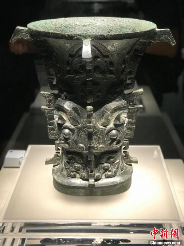 Hezun, an ancient Chinese ritual bronze wine (zun) vessel, is on display at an exhibition of bronze relics in Chengdu City, Southwest China's Sichuan Province, Aug. 6, 2018. He zun dates from the era of the early Western Zhou (1046?771 BC) and is famous as it is the oldest artifact with the written characters \