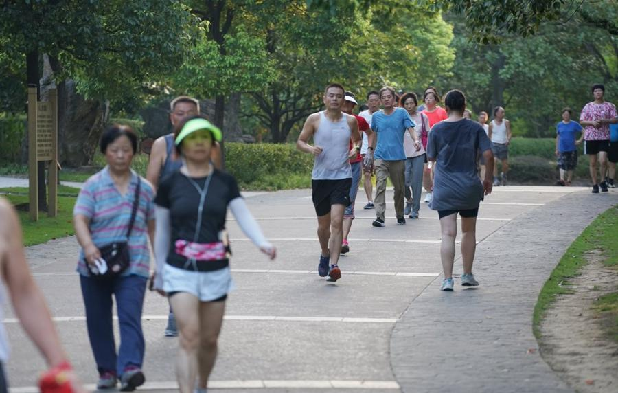 People jog at the park on August 8.