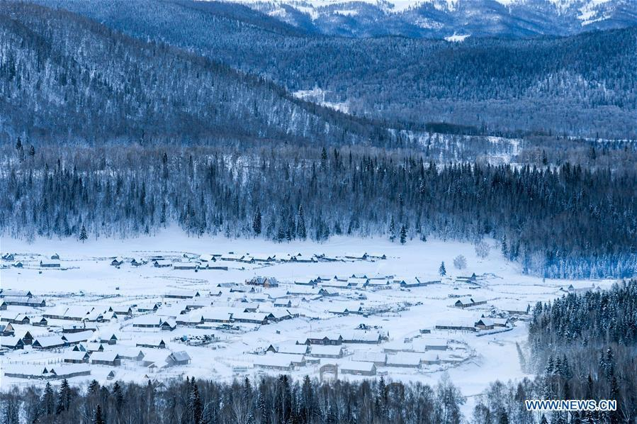 Photo taken on Jan. 2, 2018 shows a view of snowed-covered Hemu Village in the Kanas scenic area, northwest China\'s Xinjiang Uygur Autonomous Region. China\'s westernmost Xinjiang Uygur Autonomous Region welcomed a record high of 107 million tourists in 2017, up 32.4 percent year on year. In addition, tourists spent over 182 billion yuan (28.4 billion U.S. dollars) in Xinjiang last year, 30 percent more than in 2016.
