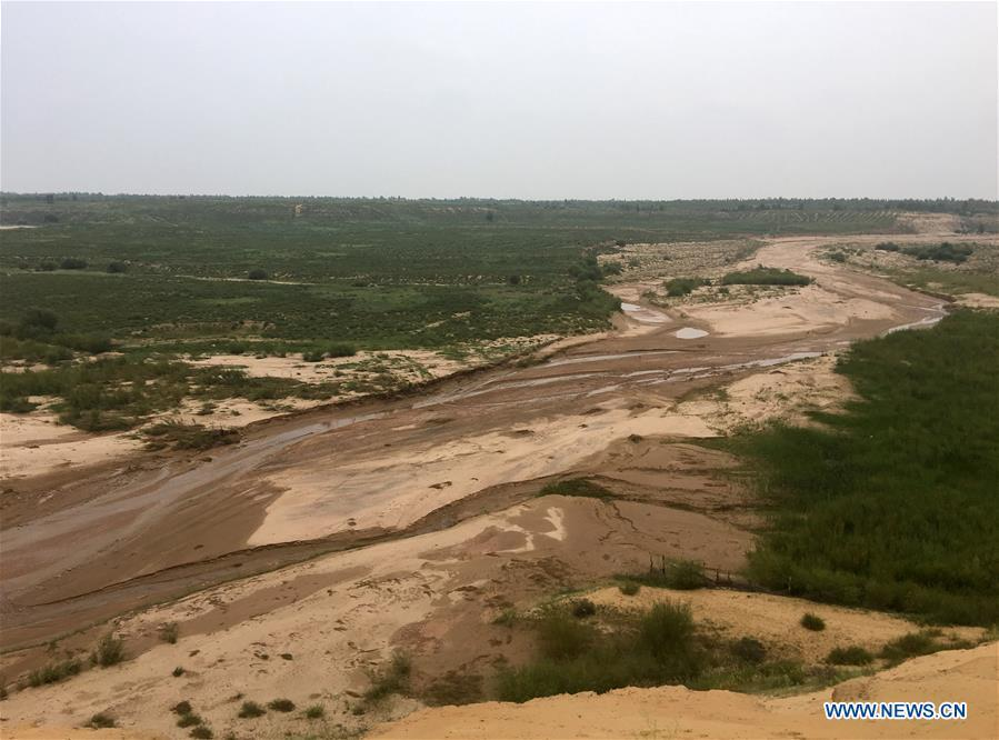 Photo taken on Aug. 1, 2018 shows a seasonal river channel at the Kubuqi Desert in Erdos, north China\'s Inner Mongolia Autonomous Region. Kubuqi, the seventh largest desert in China, is a good example of China\'s success in alleviating desertification. About 6,460 square kilometers of the Kubuqi desert has been reclaimed in the last 30 years. (Xinhua/Zhang Shanchen)