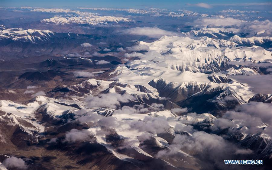 Aerial photo taken on May 15, 2018 shows the view of snow-covered Kunlun Mountains, northwest China\'s Xinjiang Uygur Autonomous Region. China\'s westernmost Xinjiang Uygur Autonomous Region welcomed a record high of 107 million tourists in 2017, up 32.4 percent year on year. In addition, tourists spent over 182 billion yuan (28.4 billion U.S. dollars) in Xinjiang last year, 30 percent more than in 2016. (Xinhua/Jiang Wenyao)