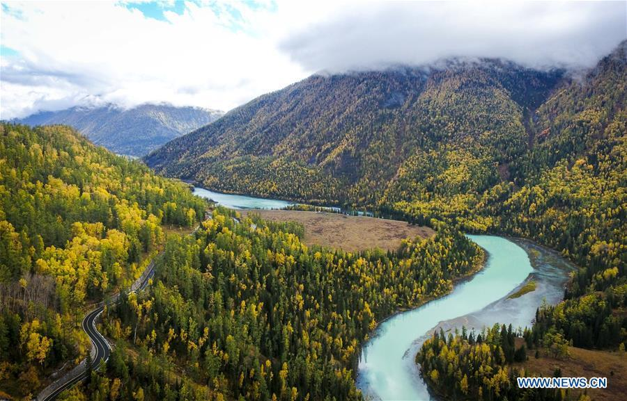 Aerial photo shows a view of the moon bay in the Kanas scenic area in northwest China\'s Xinjiang Uygur Autonomous Region, Sept. 22, 2017. China\'s westernmost Xinjiang Uygur Autonomous Region welcomed a record high of 107 million tourists in 2017, up 32.4 percent year on year. In addition, tourists spent over 182 billion yuan (28.4 billion U.S. dollars) in Xinjiang last year, 30 percent more than in 2016. (Xinhua/Zhao Ge)