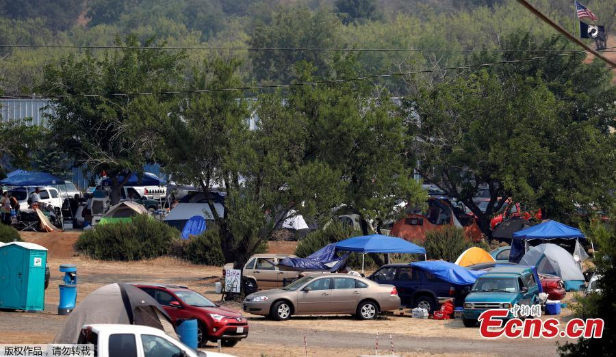 Evacuees from the Ranch Fire and River Fire (Mendocino Complex) are living in motor homes, cars and tents in the parking lot of the Moose Lodge in Clearlake Oaks, California, U.S., Aug. 2, 2018. (Photo/Agencies)