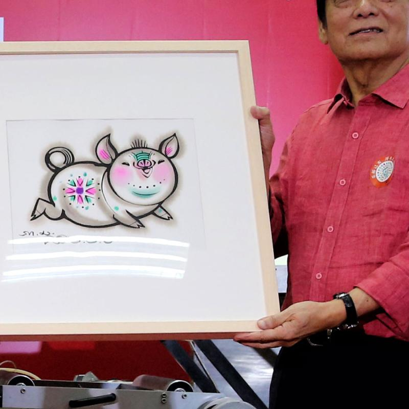 One of the two Year of Pig stamps designed by Han Meilin.  (Photo/China Daily)