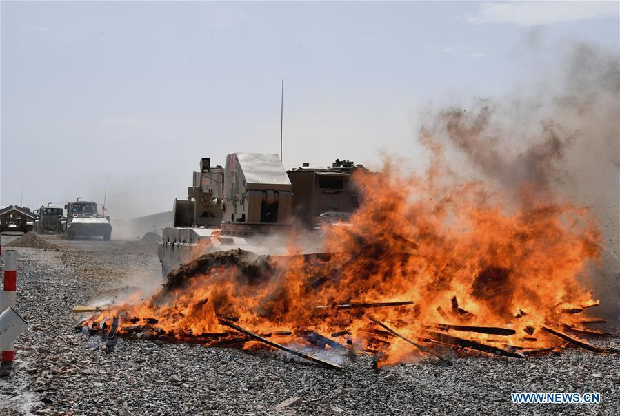 A vehicle operated by a Chinese crew cleans up the fire barrier during a match of the International Army Games 2018 in Korla, northwest China\'s Xinjiang Uygur Autonomous Region, Aug. 8, 2018. Three contests of the International Army Games 2018 in northwest China\'s Xinjiang Uygur Autonomous Region ended here Wednesday. (Xinhua/Zhang Yongjin)
