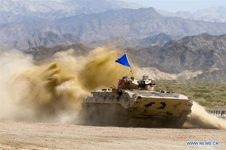 An armored vehicle operated by a Chinese crew drives during a match of the International Army Games 2018 in Korla, northwest China\'s Xinjiang Uygur Autonomous Region, Aug. 5, 2018. Three contests of the International Army Games 2018 in northwest China\'s Xinjiang Uygur Autonomous Region ended here Wednesday. (Xinhua/Wang Pengfei)