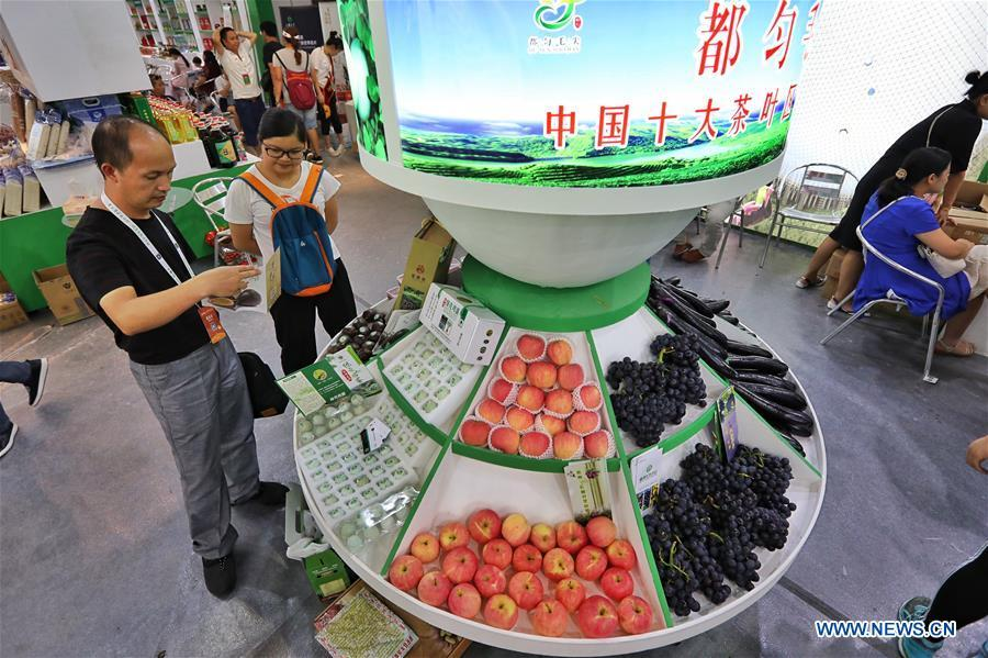 People visit a farmland products fair in Guiyang, capital of southwest China\'s Guizhou Province, Aug. 9, 2018. The five-day fair kicked off on Thursday. (Xinhua/Liu Xu)