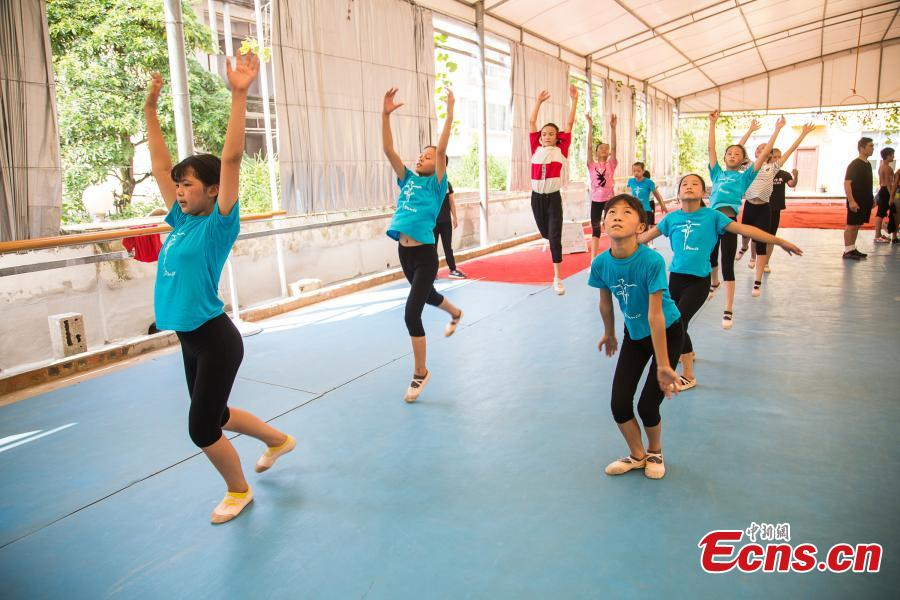 Children acrobats train at a gym in Nanning, the capital of South China's Guangxi Zhuang Autonomous Region, Aug. 9, 2018. Most of the children training with the acrobatics troupe led by Li Dewei are from the poverty-stricken Mashan County and they dream of one day improving the financial position of their families through their performances. (Photo: China News Service/Chen Guanyan)