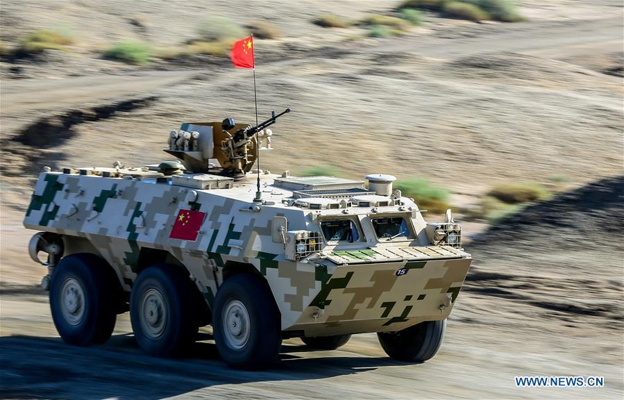 An armored vehicle operated by a Chinese crew drives during a match of the International Army Games 2018 in Korla, northwest China\'s Xinjiang Uygur Autonomous Region, Aug. 4, 2018. Three contests of the Internatio