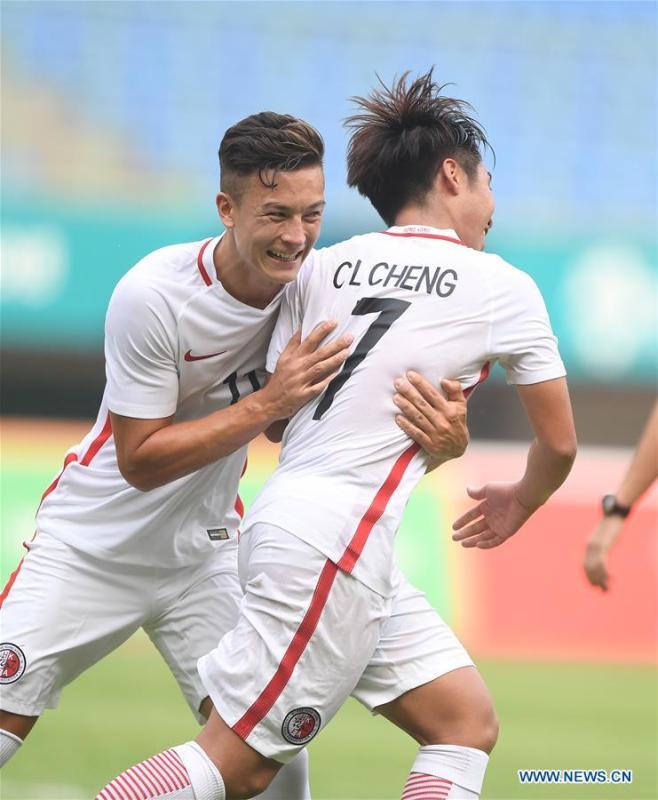 Cheng Chin Lung (R) of Hong Kong of China celebrates scoring with teammates during the Men\'s Football Group A match between Hong Kong of China and Laos at the 18th Asian Games at Patriot Stadium in Bekasi, Indonesia, Aug. 10, 2018. (Xinhua/Jia Yuchen)
