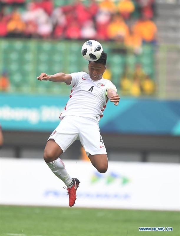 Lau Hok Ming of Hong Kong of China competes during the Men\'s Football Group A match between Hong Kong of China and Laos at the 18th Asian Games at Patriot Stadium in Bekasi, Indonesia, Aug. 10, 2018. (Xinhua/Jia Yuchen)
