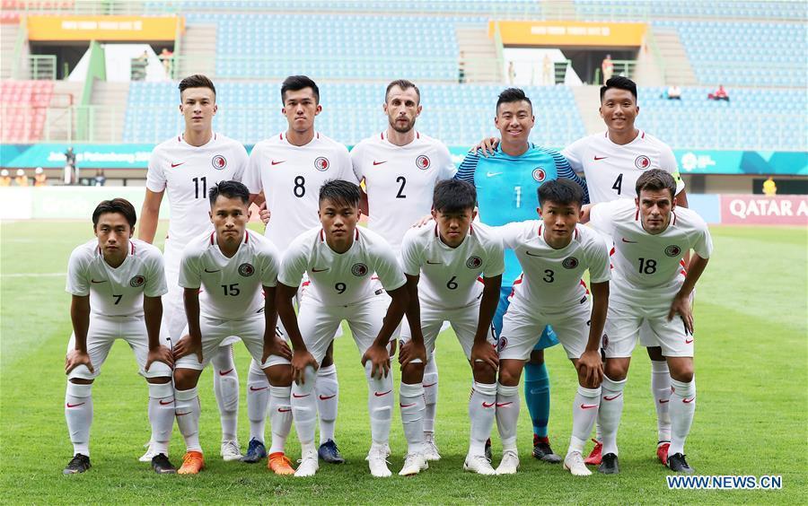 Players of Hong Kong of China line up for photos before the Men\'s Football Group A match between Hong Kong of China and Laos at the 18th Asian Games at Patriot Stadium in Bekasi, Indonesia, Aug. 10, 2018. Hong Kong of China won 3-1. (Xinhua/Wang Lili)