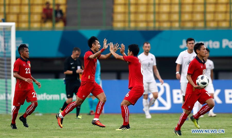 Natphasouk Soukchinda (front 2nd L) of Laos celebrates after scoring during the Men\'s Football Group A match between Hong Kong of China and Laos at the 18th Asian Games at Patriot Stadium in Bekasi, Indonesia, Aug. 10, 2018. Hong Kong of China won 3-1. (Xinhua/Wang Lili)